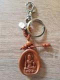 Acala Boeddha hanger bruin