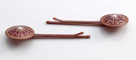 2 haarspelden, bronskleurig
