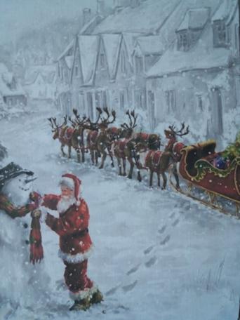 Bordje, kerstman in de sneeuw