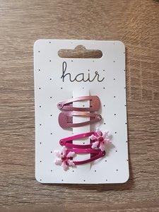 2 sets rozekleurige haarspelden